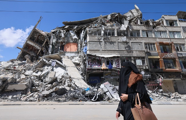 Israel says Hamas used destroyed media building to jam air defences, rebuild house